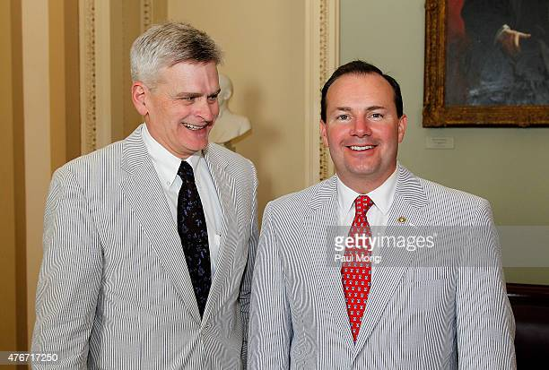 Sen Bill Cassidy and Sen Mike Lee pose for a photo during National Seersucker Day at the US Capitol Building on June 11 2015 in Washington DC