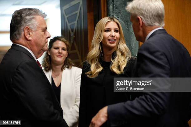 Sen Bill Cassidy at right and Rep Peter King at left speak with White House Senior Advisor Ivanka Trump ahead of a Commerce Committee hearing on paid...