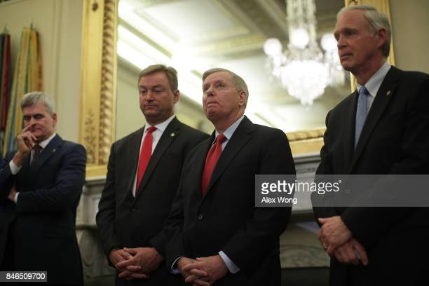Sen. Bill Cassidy , Sen. Dean Heller , Sen. Lindsey Graham and Sen. Ron Johnson attend a news conference on health care September 13, 2017 on Capitol...