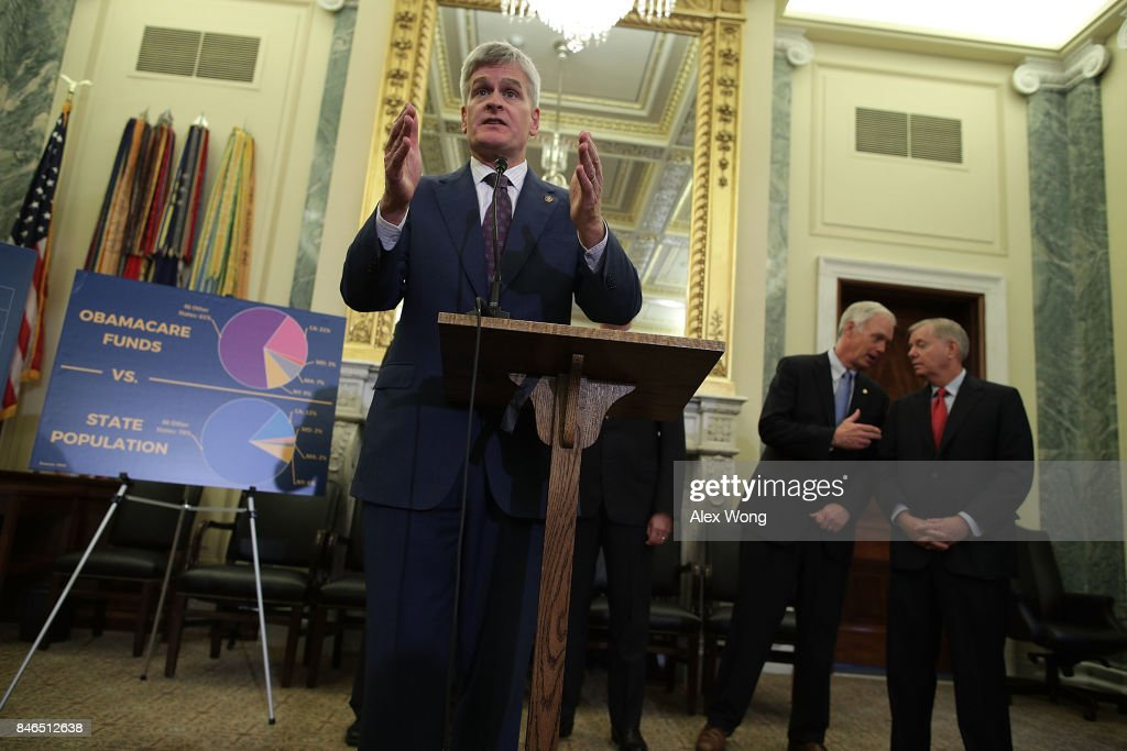 U.S. Sen. Bill Cassidy (R-LA) speaks as Sen. Ron Johnson (R-WI) and Sen. Lindsey Graham (R-SC) talk to each other during a news conference on health care September 13, 2017 on Capitol Hill in Washington, DC. Senators Graham, Cassidy, Heller and Johnson unveiled a proposed legislation to repeal and replace the Obamacare.