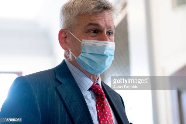 Sen. Bill Cassidy speaks to members of the media while arriving to Senate Republican policy luncheons at the Russell Senate Office Building on April...