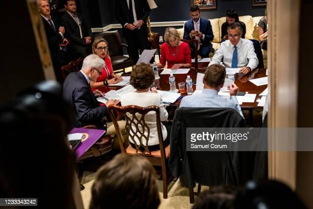 Sen. Bill Cassidy , U.S. Sen. Kyrsten Sinema , U.S. Sen. Lisa Murkowski , and U.S. Sen. Mitt Romney hold a bipartisan meeting on infrastructure in...