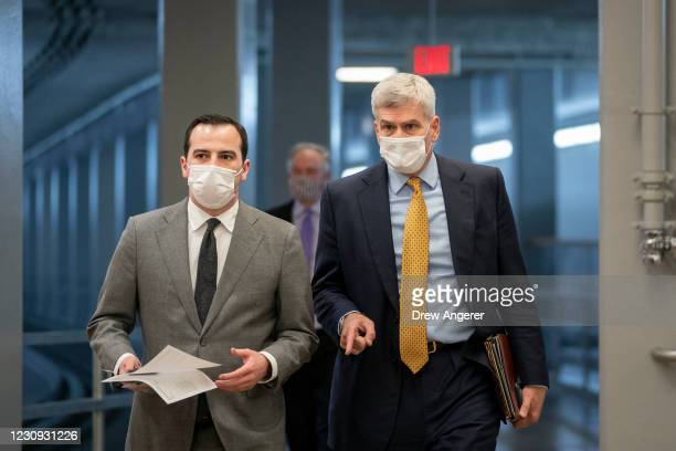 Sen. Bill Cassidy walks with an aide in the Senate subway on his way to a vote at the U.S. Capitol on February 2, 2021 in Washington, DC. On Tuesday...