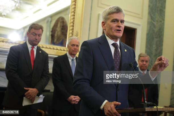 Sen. Bill Cassidy speaks as Sen. Dean Heller , Sen. Ron Johnson and Sen. Lindsey Graham listen during a news conference on health care September 13,...
