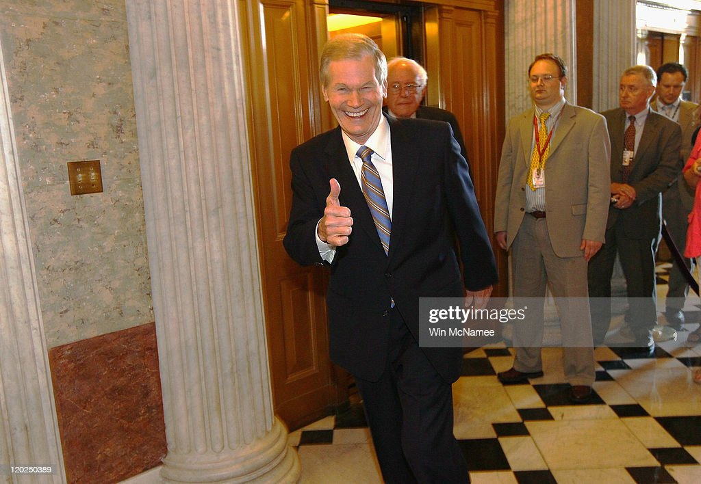 Sen. Bill Nelson (D-FL), followed by Sen. Bernie Sanders (I-VT), gives a thumbs up as he walks to vote on the debt limit bill on August 2, 2011 in Washington, DC. The Senate voted 74-26 to approve the bill to raise the debt ceiling, allowing the U.S. to avoid default on its debts.