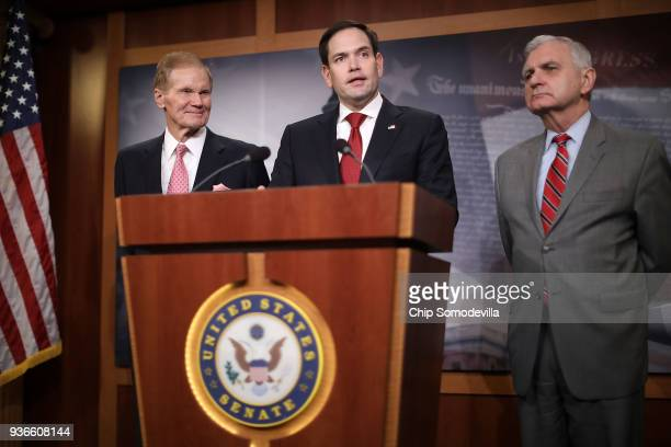 Sen Bill Nelson Sen Marco Rubio and Sen Jack Reed talk about their bipartisan legislation to create red flag gun laws during a news conference at the...