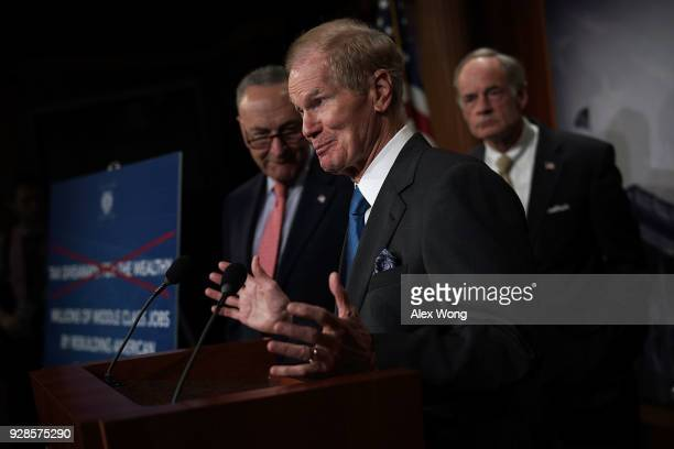 Sen. Bill Nelson speaks as Senate Minority Leader Sen. Chuck Schumer and Sen. Tom Carper listen during a news conference at the Capitol March 7, 2018...
