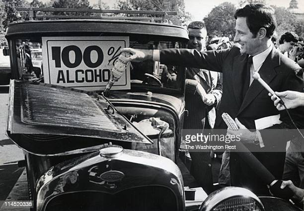 Sen Birch Bayh is shown adding alcohol from a vodka bottle to the tank of this antique Ford which is 100% alcoholpowered There was a demonstration at...