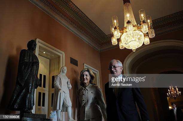 S Sen Bob Corker and Sen Kay Bailey Hutchison arrive on Capitol Hill for a postponed vote on the debt ceiling on July 31 2011 in Washington DC As the...