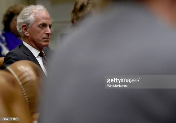 Sen Bob Corker listens as Ivanka Trump leads a meeting on human trafficking in the Roosevelt Room of the White House May 17 2017 in Washington DC...
