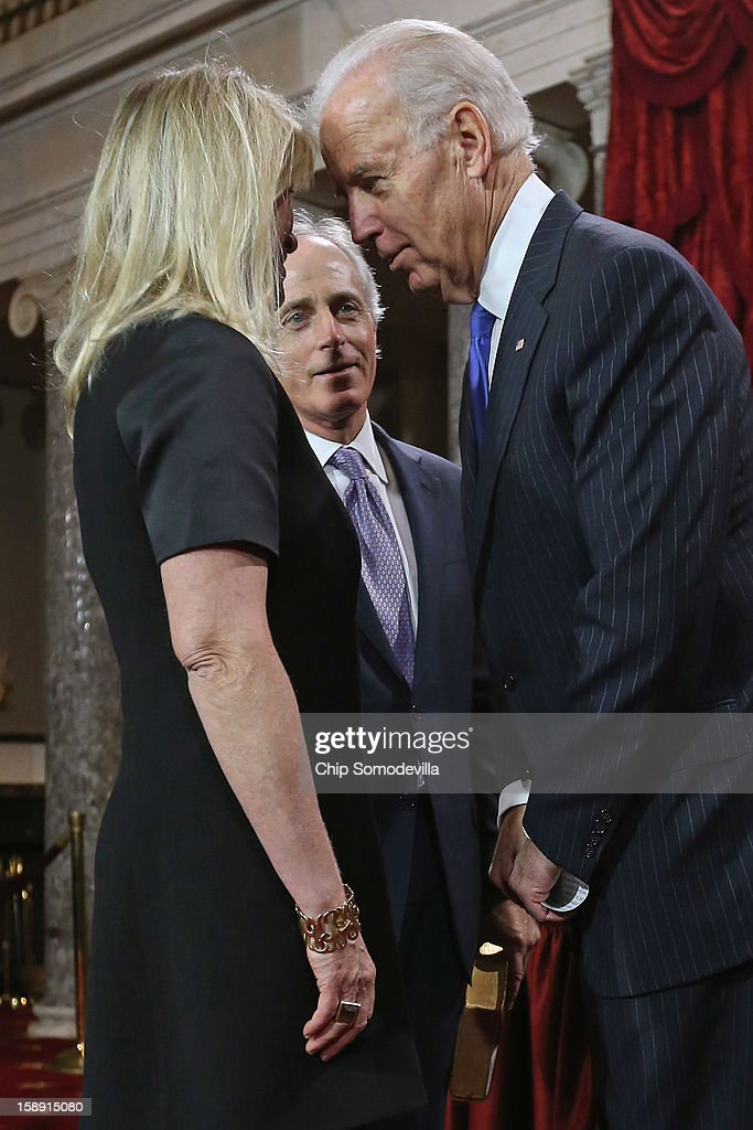 U.S. Sen. Bob Corker (R-TN) (C) looks on as his wife Elizabeth Corker talks with U.S. Vice President Joe Biden during a reenacted swearing-in in the Old Senate Chamber at the U.S. Capitol January 3, 2013 in Washington, DC. Biden swore in the newly-elected and re-elected senators earlier in the day on the floor of the current Senate chamber.