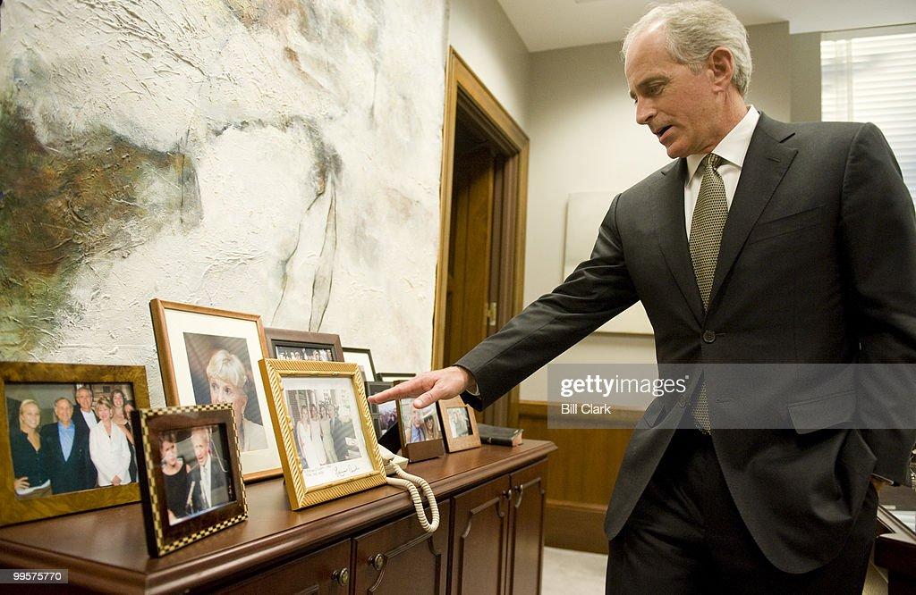 Sen. Bob Corker, R-Tenn., shows off family photos his offices in the Dirksen Senate Office Building on Thursday, Jan. 22, 2009.