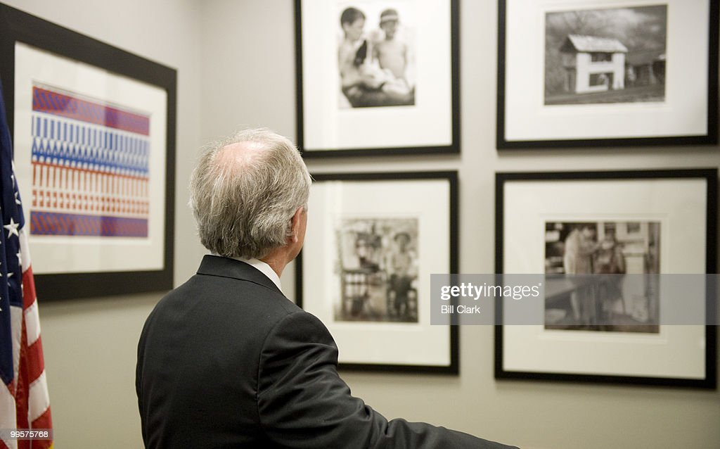 Sen. Bob Corker, R-Tenn., shows off the John Poteete photographs hanging on thew walls of his offices in the Dirksen Senate Office Building on Thursday, Jan. 22, 2009.