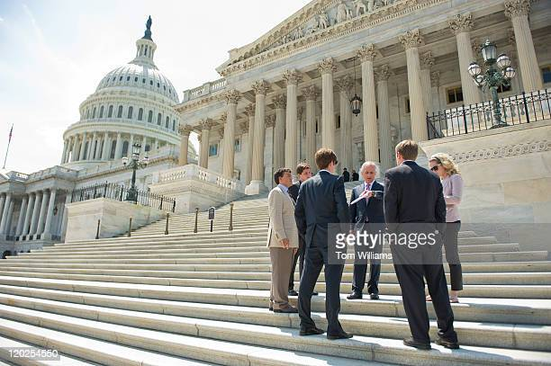 Sen Bob Corker RTenn talks to some of his interns on the Senate steps of the Capitol after the Senate passed a deal to raise the nation's debt limit...