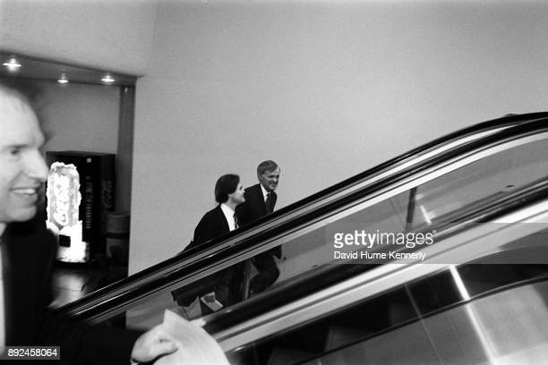 Sen Bob Kerrey of Nebraska rides the escalator of the US Capitol building on his way to the second to last day of the Senate Impeachment Trial of...