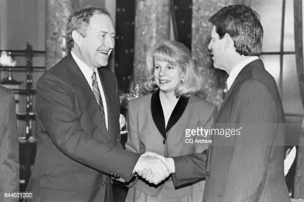 Sen Bob Krueger DTex shaking hands with Vice President Al Gore in Old Seante Chamber while Krueger's wife Kathleen Krueger looks on Jan 25 1993 n