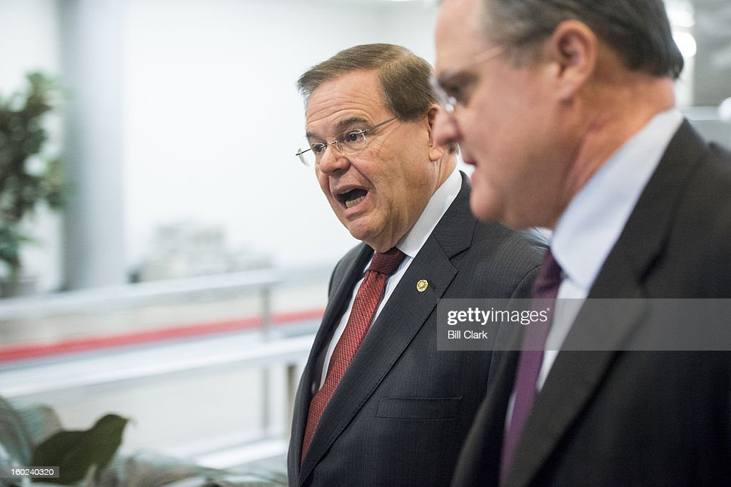 Sen. Bob Menendez, D-N.J., left, and Sen. Mark Pryor, D-Ark., talk as they arrive in the Capitol via the Senate subway on Monday, Jan. 28, 2013. Menendez was on his way to the news conference to announce details of a new bipartisan immigration plan.