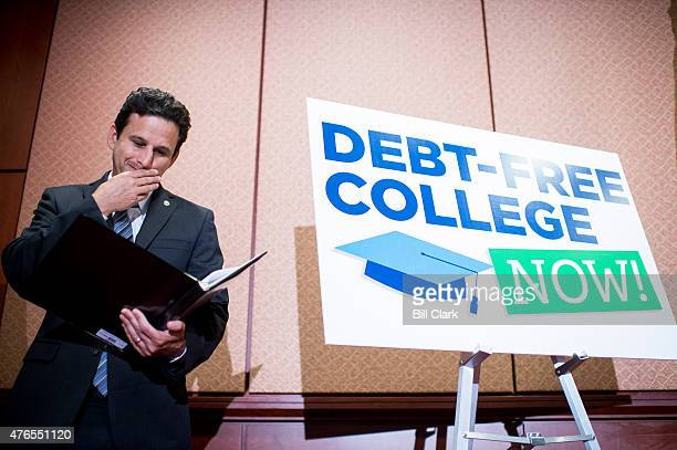 Sen Brian Schatz DHawaii looks over his notes during the press conference in the Capitol to call for the elimination of student loan debt at public...