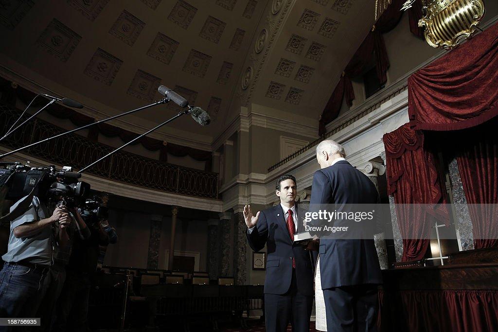 Sen. Brian Schatz (D-HI) (L) participates in a ceremonial swearing in event with Vice President Joe Biden, in the Old Senate Chamber on Capitol Hill, on December 27, 2012 in Washington, DC. Schatz is filling the late Sen. Daniel Inouye's (D-HI) seat in the Senate.