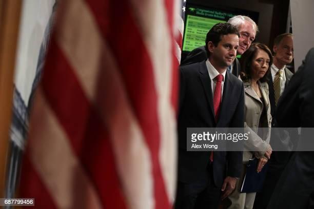 Sen. Brian Schatz , Sen. Edward Markey , Sen. Maria Cantwell and Sen. Tom Carper listen during a news conference at the Capitol May 24, 2017 in...