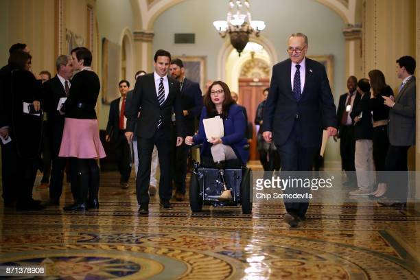 Sen Brian Schatz Sen Tammy Duckworth and Senate Minority Leader Charles Schumer arrive for a news conference following the weekly Democratic policy...