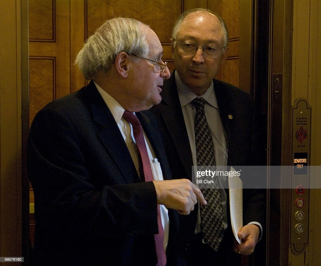 Sen. Carl Levin, D-Mich., and Sen. Ken Salazar, D-Colo., talk as they get off the elevator on their way to the Senate Democratic Policy Committee luncheon in the U.S. Capitol on Tuesday, May 1, 2007.