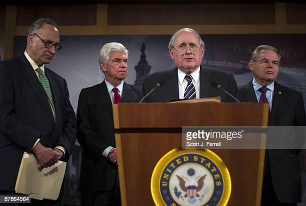 Sen Charles E Schumer DNY Sen Christopher J Dodd DConn Sen Carl Levin DMich and Sen Robert Menendez DNJ during a news conference after the Senate...