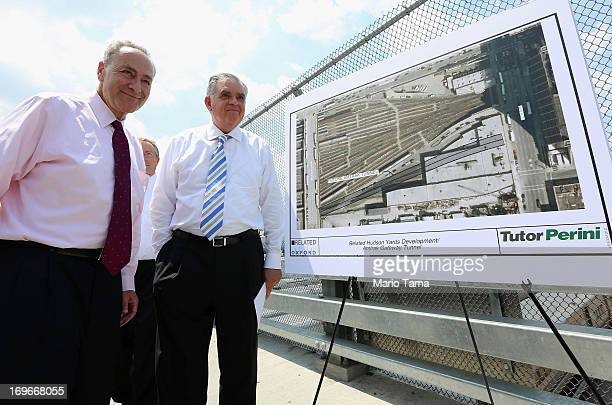 S Sen Charles Schumer and US Transportation Secretary Ray LaHood wait to speak at a news conference at the Hudson Yards site in Manhattan on May 30...