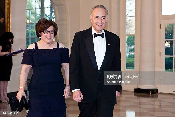Sen Charles Schumer arrives with Iris Weinshall for a State Dinner in honor of British Prime Minister David Cameron at the White House on March 14...