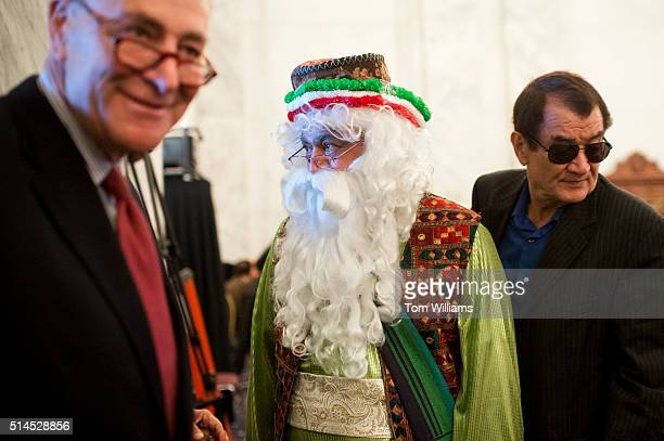Sen Charles Schumer DNY left and Nader Moavenian center who is dressed as 'Uncle Nowruz' attend a celebration of the Persian New Year Nowruz in the...