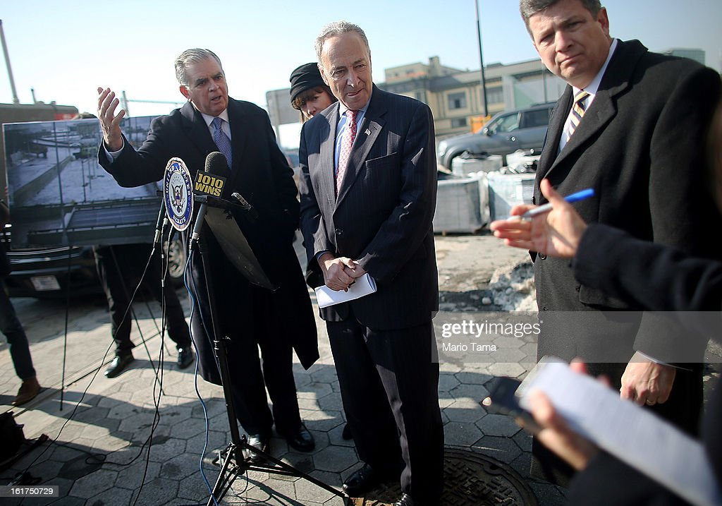 U.S. Sen. Charles Schumer (C), D-NY, looks on as U.S. Secretary of Transportation Ray LaHood (L) answers a question next to a photo of Hurricane Sandy flooding on February 15, 2013 in New York City. LaHood announced that New York state will receive $250 million in fast track funding to repair road infrastrcture damaged by Hurricane Sandy.