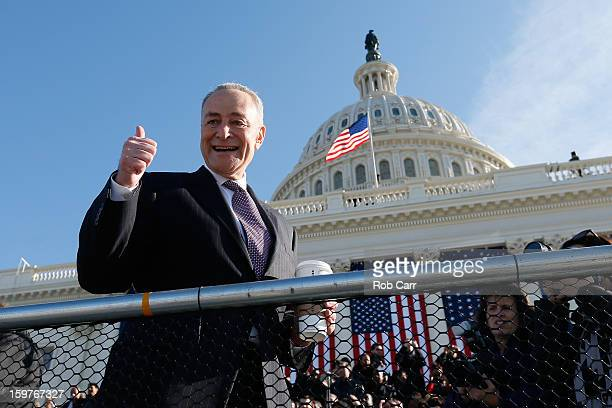 S Sen Charles Schumer greets people at the US Capitol building as Washington prepares for US President Barack Obama's second inauguration on January...