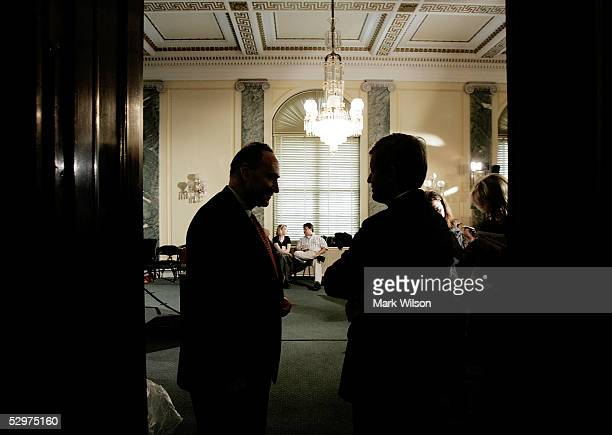 S Sen Charles Schumer talks with US Sen Max Baucus before a news conference on Capitol Hill May 24 2005 in Washington DC The news conference focused...