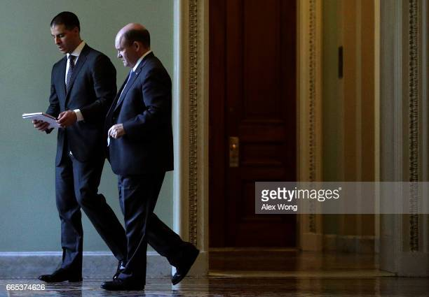 S Sen Chris Coons talks to an aide at the Capitol April 6 2017 in Washington DC Senate Republicans have voted to invoke the so called 'nuclear...