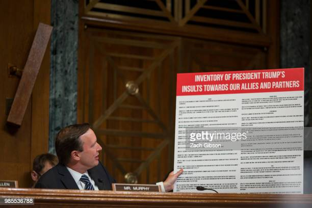 Sen Chris Murphy holds a sign during a Senate Appropriations Subcommittee on Sate Foreign Operations and Related Programs hearing to review the...