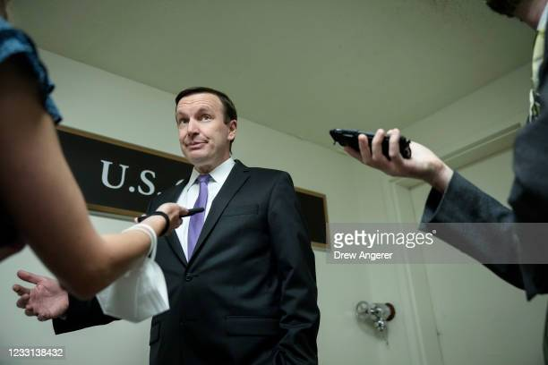 Sen. Chris Murphy talks with reporters as he walks through the Senate subway on his way to a vote at the U.S. Capitol May 27, 2021 in Washington, DC....