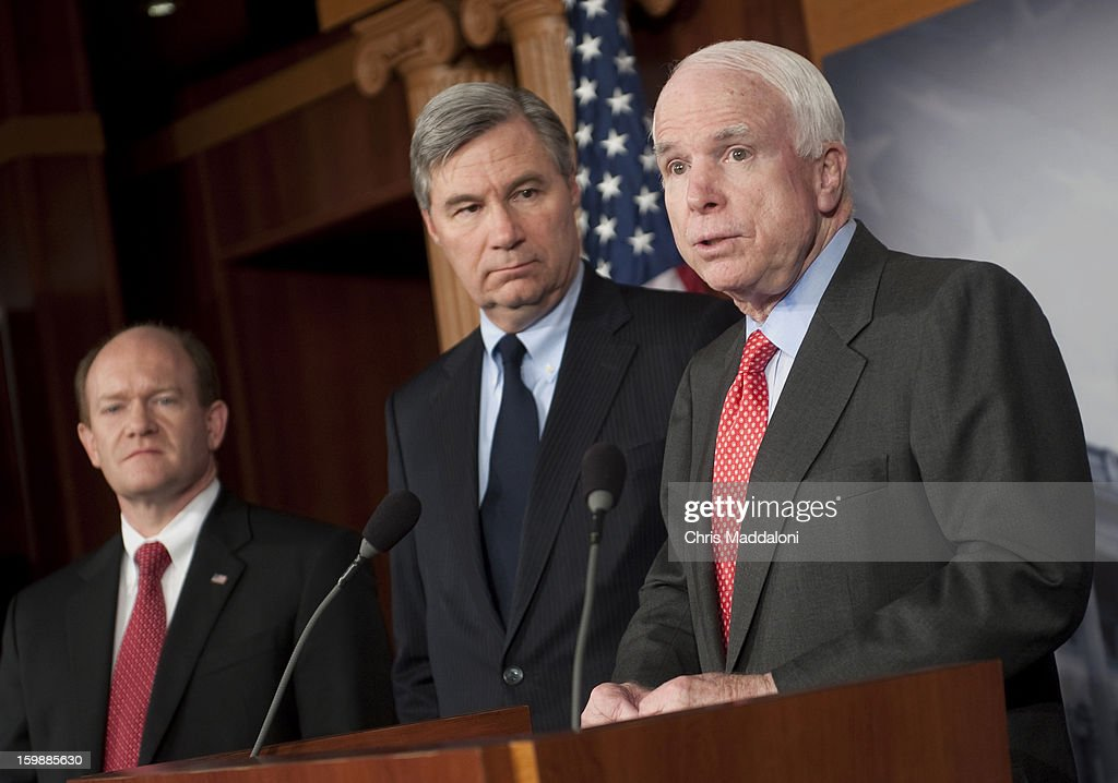 Sen. Christopher Coons, D-Del.; Sen. Sheldon Whitehouse, D-R.I.; and Sen. John McCain, R-Ariz., speak at a press conference about a recent congressional trip to Syria, Afghanistan and Egypt.