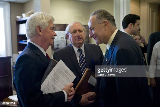Sen Christopher J Dodd DConn Sen Carl Levin DMich and Sen Charles E Schumer DNY before a news conference after the Senate passed legislation Tuesday...
