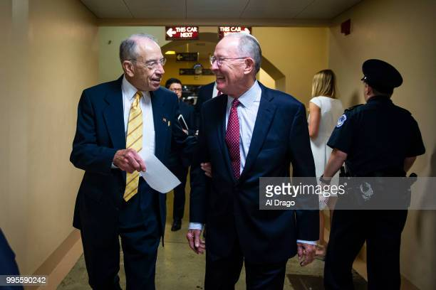 Sen Chuck Grassley and Sen Lamar Alexander confer as they depart the US Capitol following a vote on July 10 2018 in Washington DC
