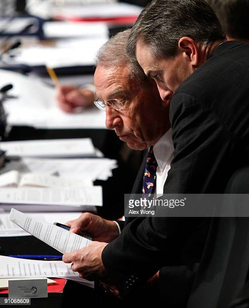 S Sen Chuck Grassley listens to an aide during a mark up hearing before the US Senate Finance Committee on Capitol Hill September 23 2009 in...