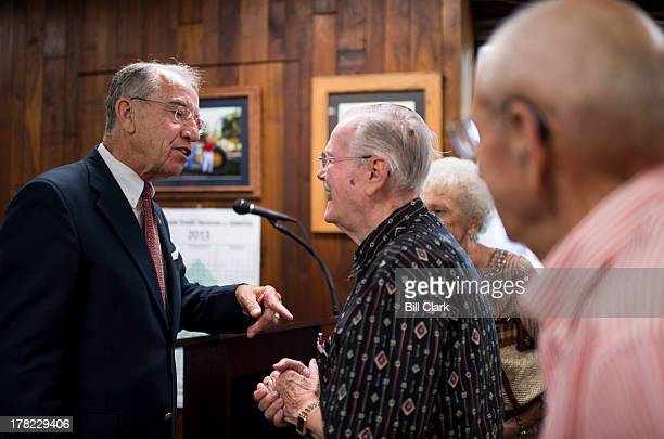 Sen. Chuck Grassley, R-Iowa, speaks with constituents after his Clay County town hall meeting on Tuesday, Aug. 27 in Spencer, Iowa, as part of his...