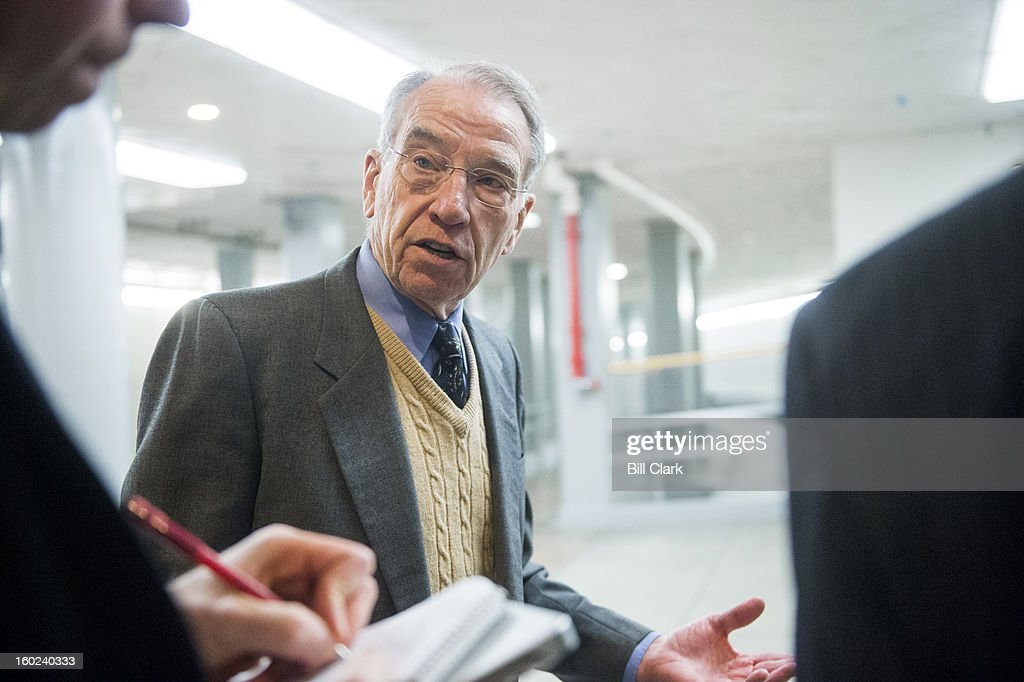 Sen. Chuck Grassley, R-Iowa, speaks with reporters as he leaves the Capitol via the Senate subway on Monday, Jan. 28, 2013.