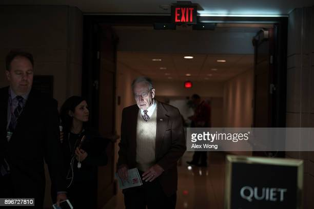 Sen. Chuck Grassley speaks to reporters in a hallway December 21, 2017 on Capitol Hill in Washington, DC. Congress is trying to pass a short term...