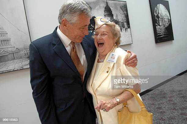 Sen Chuck Hagel RNeb hugs Gold Star Wives founder Marie Speer during an awards ceremony honoring members of Congress who have aided surviving...