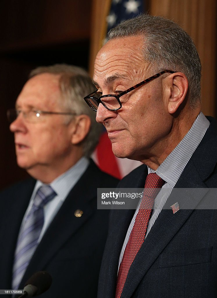 Sen. Chuck Schumer (D-NY) (R) and Senate Majority Leader Harry Reid (D-NV) speak to the media during a news conference on Capitol Hill, September 19, 2013 in Washington, DC. Leader Reid spoke about the continuing resolution and Republican efforts to defund Obamacare.
