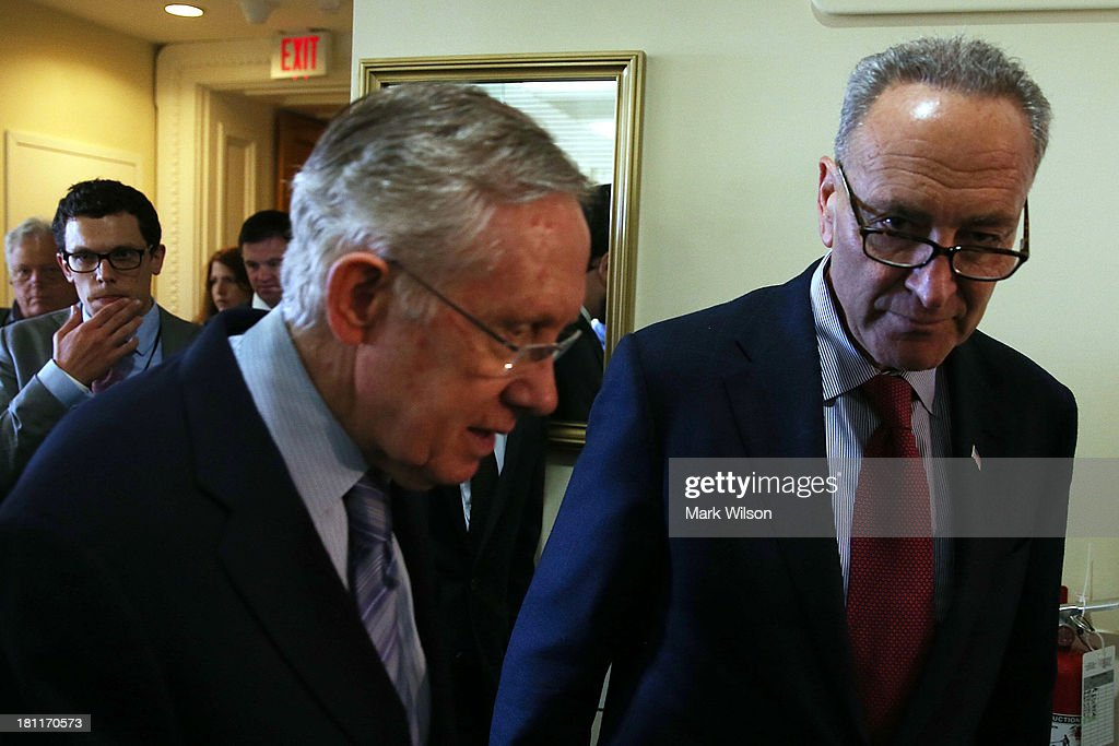 Sen. Chuck Schumer (D-NY) (R) and Senate Majority Leader Harry Reid (D-NV) walk into a news conference on Capitol Hill, September 19, 2013 in Washington, DC. Leader Reid spoke about the continuing resolution and Republican efforts to defund Obamacare.