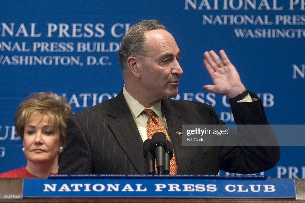 Sen. Chuck Schumer, chairman of the Democratic Senatorial Campaign Committee, answers a question from the audience as Sen. Elizabeth Dole, chairwoman of the National Republican Senatorial Committee, listens at the National Press Club Luncheon on Wednesday, Oct. 25, 2006.