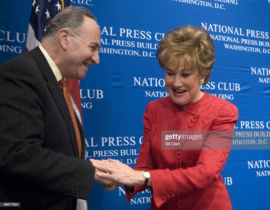 Sen. Chuck Schumer, chairman of the Democratic Senatorial Campaign Committee, and Sen. Elizabeth Dole, chairwoman of the National Republican Senatorial Committee, shake hands before the start of the National Press Club Luncheon featuring the two senators on Wednesday, Oct. 25, 2006.