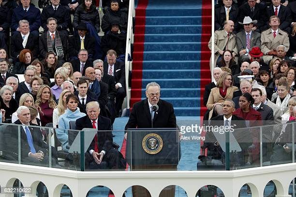 Sen Chuck Schumer delivers remarks as PresidentElect Donald Trump looks on on the West Front of the US Capitol on January 20 2017 in Washington DC In...