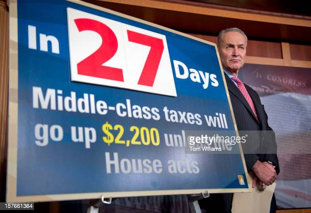 Sen Chuck Schumer DNY attends a news conference in the Capitol calling on the House to act on a Senate passed tax cut bill that would help the middle...